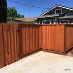 Stained Board on Board Picture Framed Fence with Arched Gate